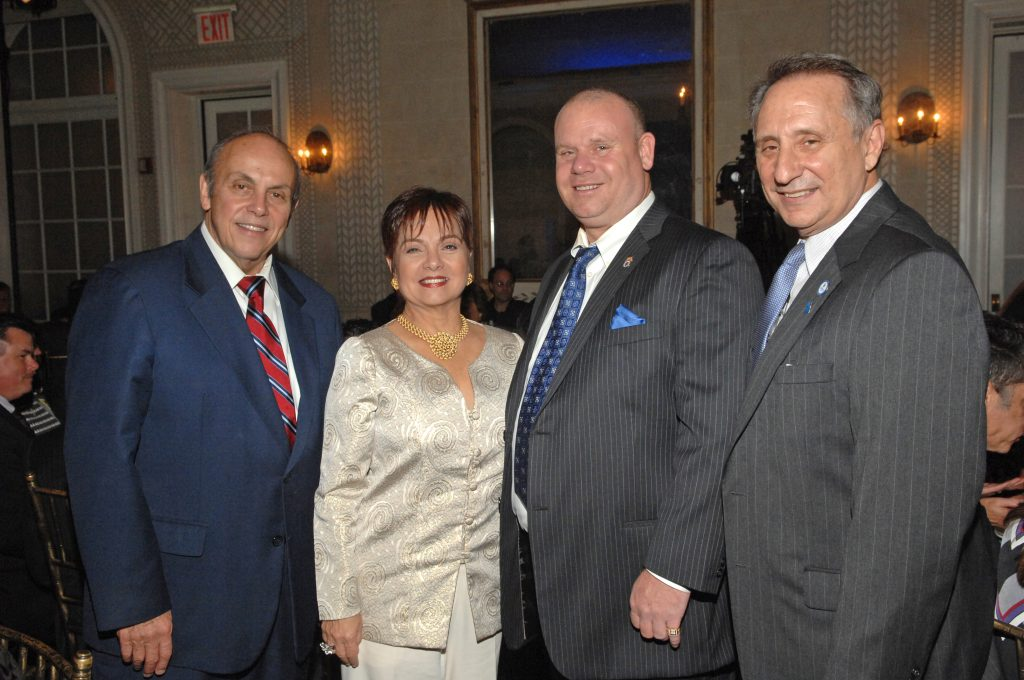 President Fernández, Myrna Rivera, honoree John Ulrich and Mario DellaPina, VP of Institutional Advancement for Lehman College.