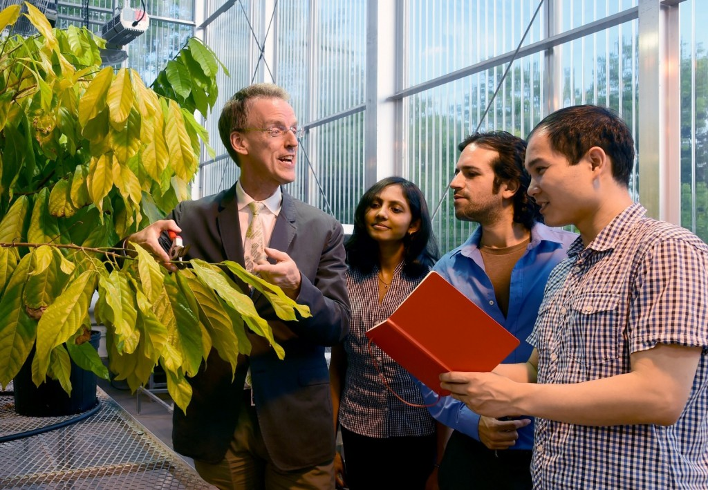 Professor Ed Kennelly and Students in Greenhouse